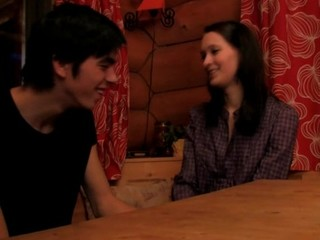Brunette hair undresses and enjoys sex on a wooden table