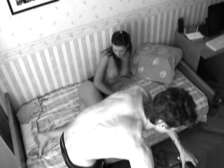 Web camera lens films as guy is nailing chick in black-and-white quality